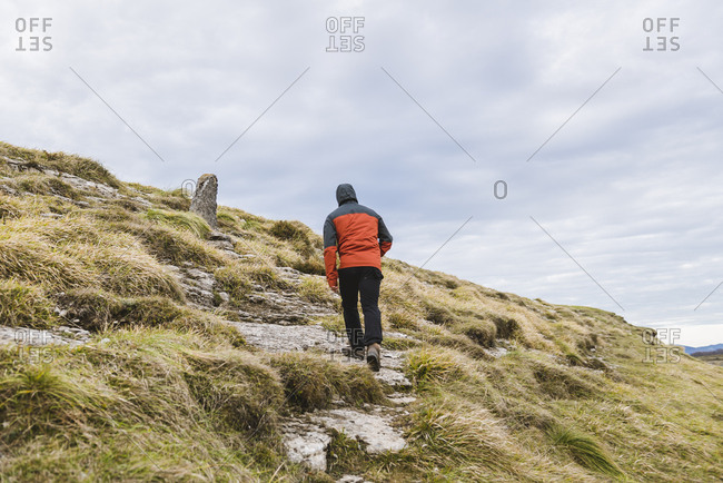 Man walking on hill near valley