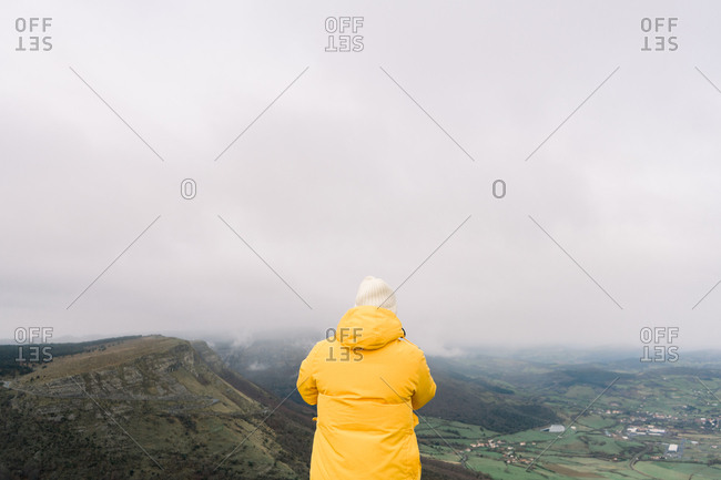 Man standing on top of hill