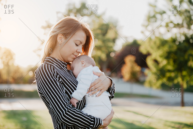 young mother hugging his baby with down syndrome