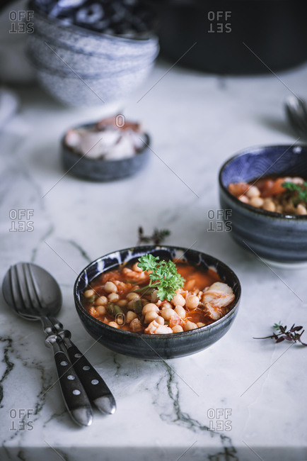 Stew pot of freshly made on a bowl placed on white marble counter