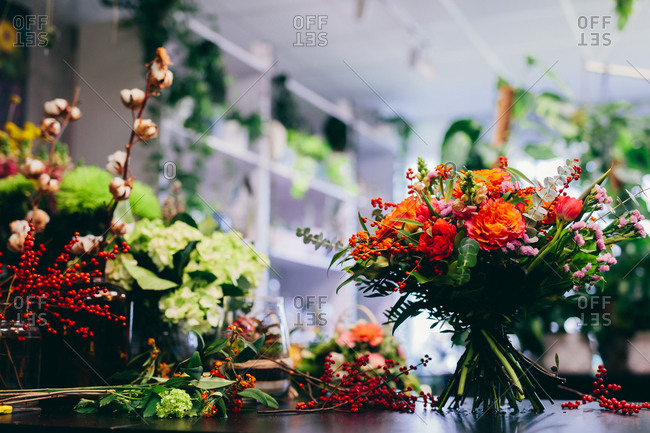 Flower shop counter with bouquet. Florist, small business, retailing. Natural floral decoration.