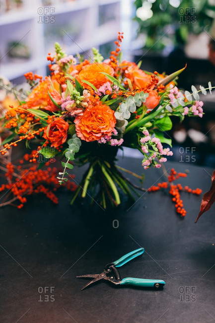 Floral bouquet on the counter in flower shop. Small business, professional occupation, florist.