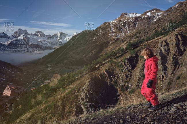 Boy in ski cloth with ski sunglasses on hill