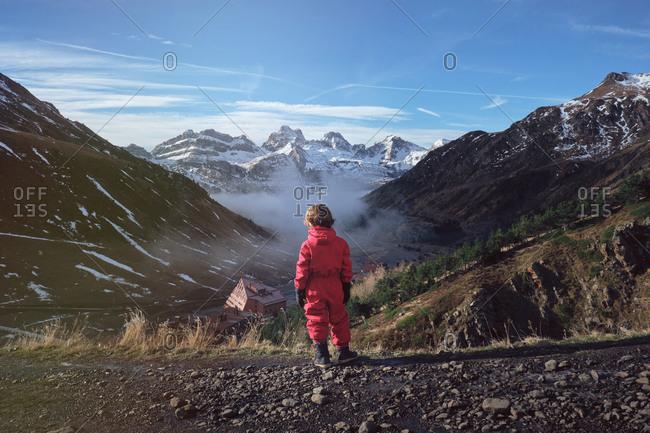 Boy in ski cloth standing on hill