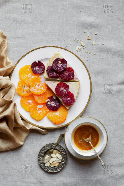 Slices of gluten free blood orange ricotta tart