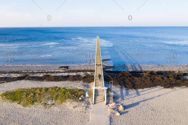 Elevated view of long pier on ocean coast