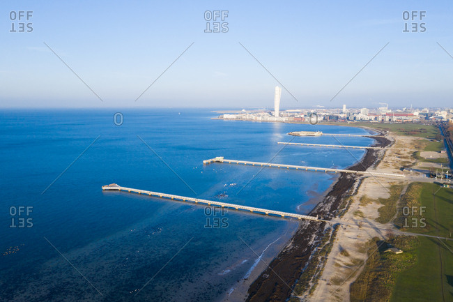 Aerial view over piers on ocean coast
