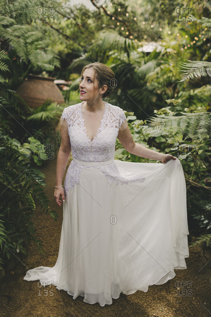 Portrait of a beautiful bride surrounded by plants