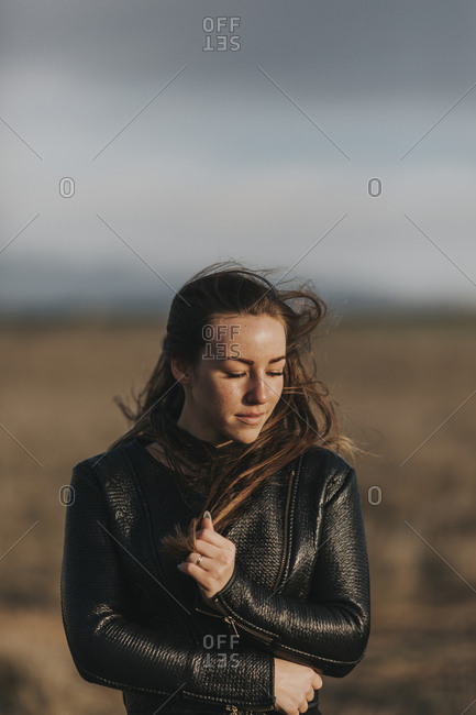 Young woman with long hair blowing in wind