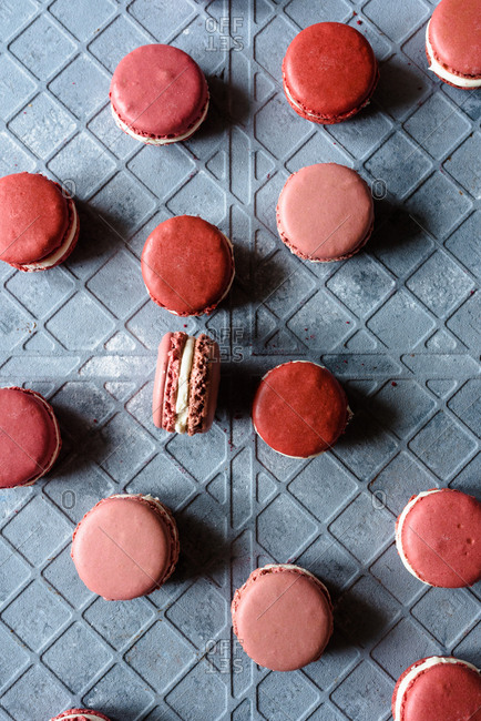Macarons in different pink shades on a gray background