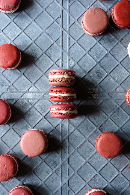 Pink macarons in different shades on a gray background