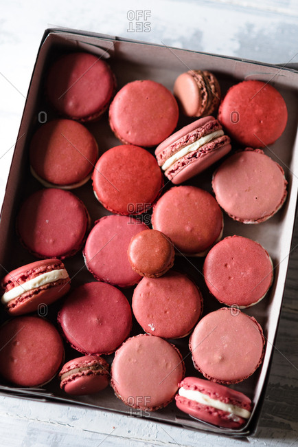 Macarons in different pink shades in a box