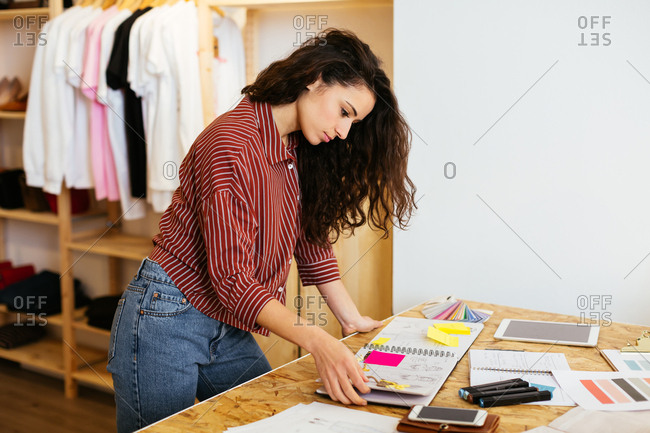 Side view of a designer working in her studio. .