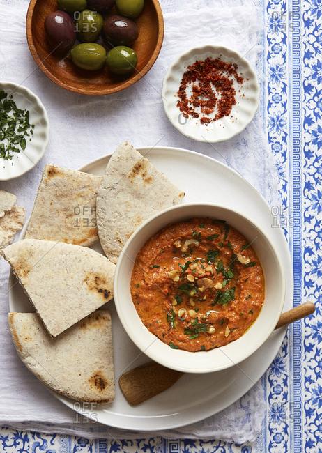 Muhammara with Pita Bread and Olives