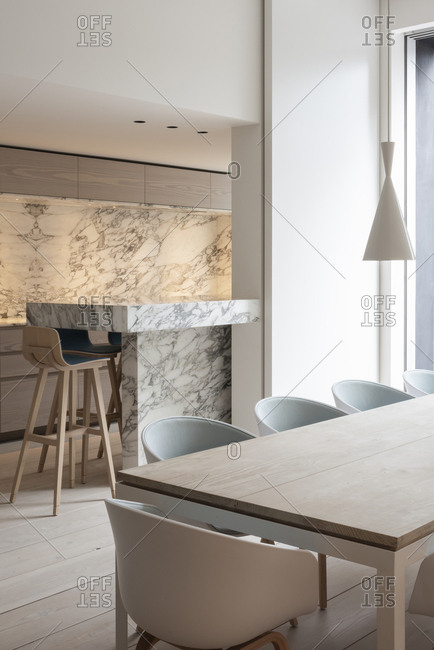 Minimalistic and modern dining room with marble counter in Brussels,  Belgium