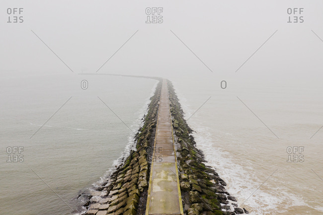 A pier leading into the North Sea in the Netherlands, seen from a higher perspective