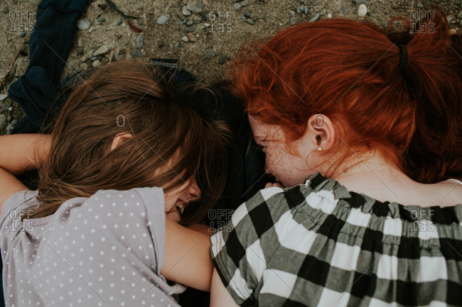 Two girls on ground laughing