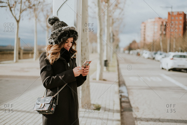 Woman using cell phone outside