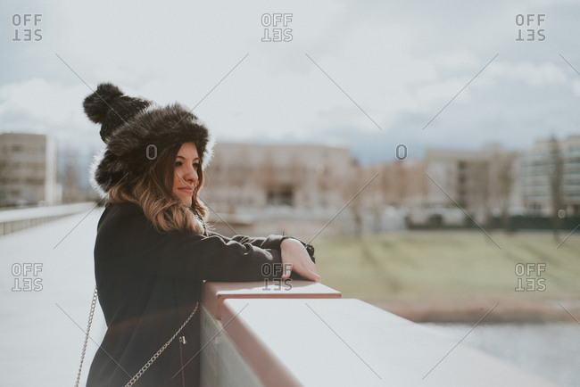 Woman looking over bridge