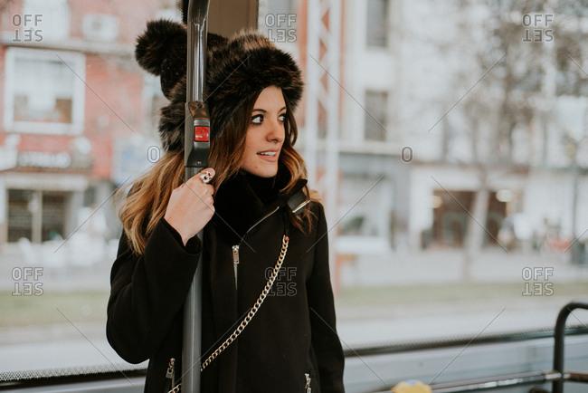 Woman riding public transportation