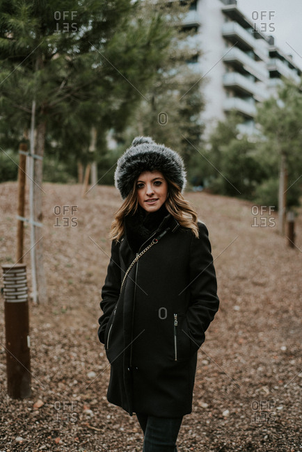 Young woman posing in winter clothing