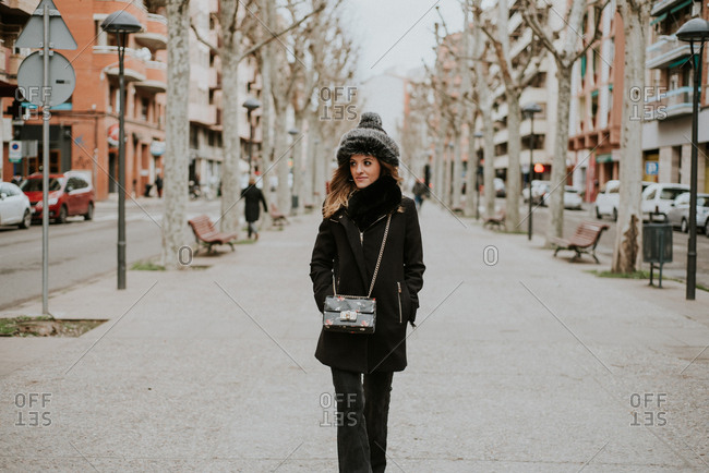 Fashionable millennial on a city street in winter