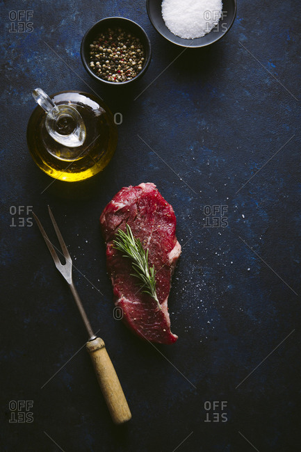 Steak with seasoning overhead shot