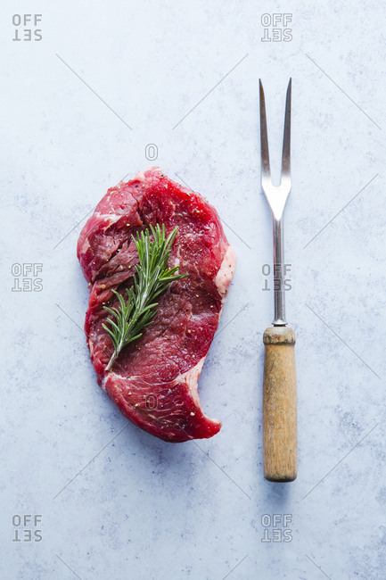 Seasoned sirloin steak with fork overhead shot
