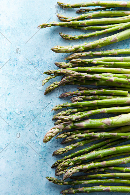 Row of fresh asparagus overhead shot
