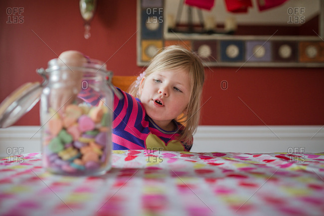 Little girl eating candy hearts