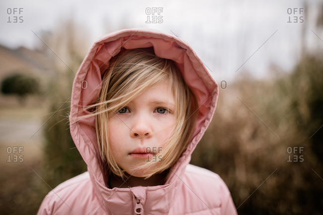 Little girl looking cold in a winter coat