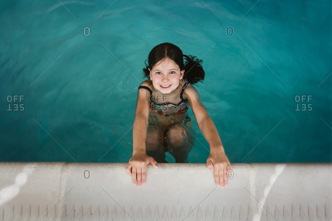 Little girl happily playing in a indoor pool