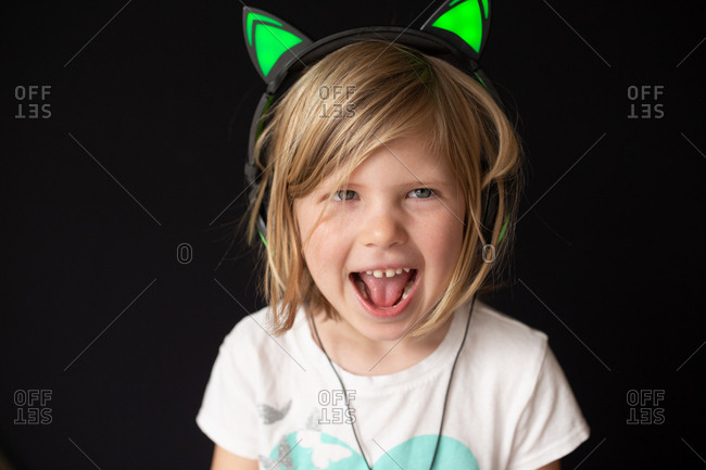 Little girl singing and listening to music