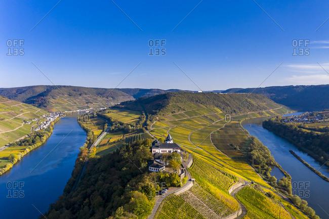 Germany- Rhineland-Palatinate- vineyards and Marienburg near Puenderich- Moselle river