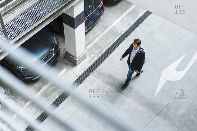 Businessman walking in parking garage