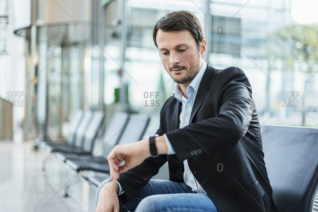 Businessman sitting at the airport- waiting