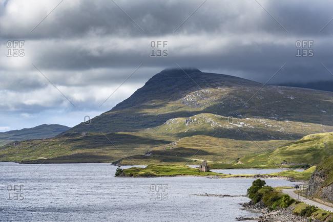 United Kingdom- Scotland- Scottish Highland- Sutherland- Ardvreck Castle- Loch Assynt- Spidean Coinich mountain in the background