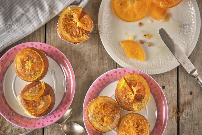 Preparing muffins with candied orange slices