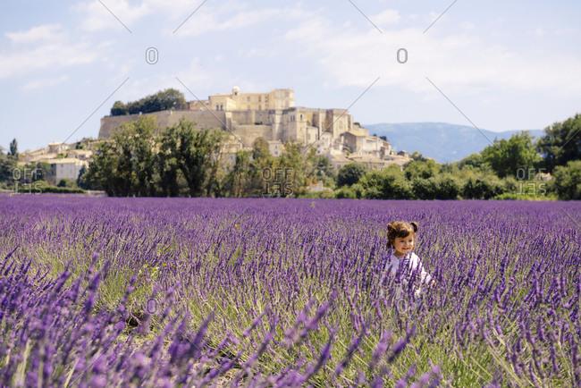 France- Grignan- happy baby girl in lavender field