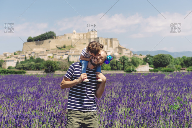 France- Grignan- father and little daughter having fun together in lavender field