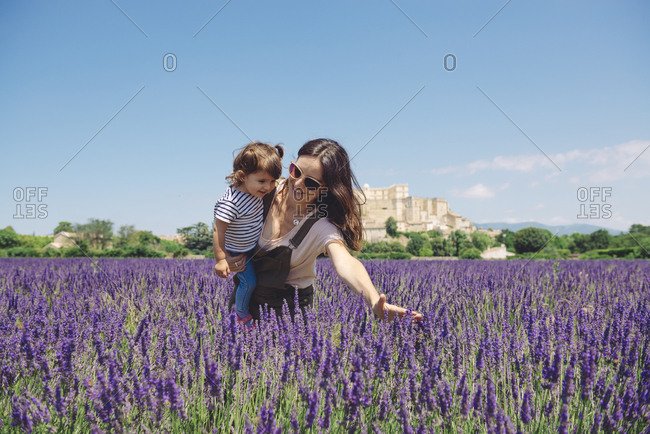 France- Grignan- mother and little daughter having fun together in lavender field