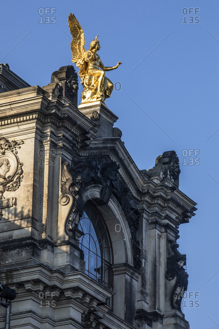 Germany- Dresden- part of facade of academy of fine arts with golden angel statue