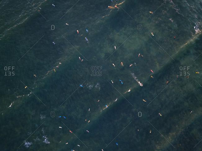 Indonesia- Bali- Canggu- Aerial view of surfers at Batu bologna beach