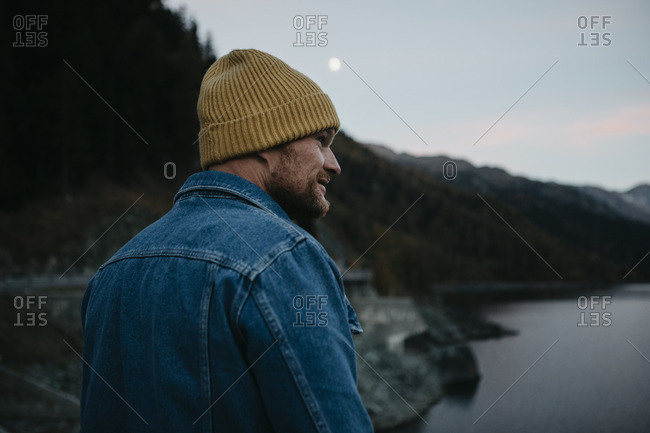 Mature man travelling through Switzerland- standing in nature