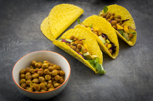 Vegetarian tacos with curcuma- roasted chickpeas- paprika- avocado- salad and red cabbage