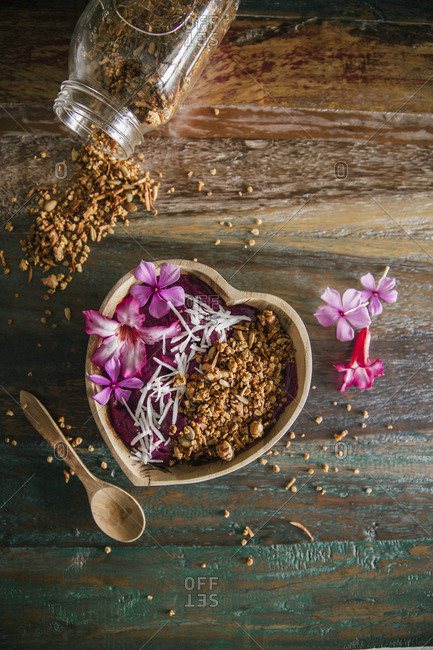 Acai Bowl with coconut flakes and pumpkin granola
