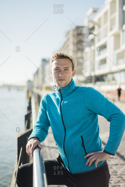 Portrait of a sportive man at he river