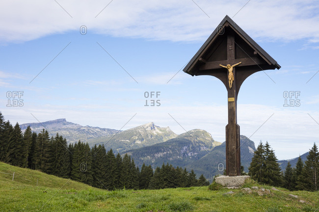 August 27, 2018: Germany- Bavaria- Allgaeu- Allgaeu Alps- Soellereck- wayside cross mit Gottesacker and Hoher Ifen in the background