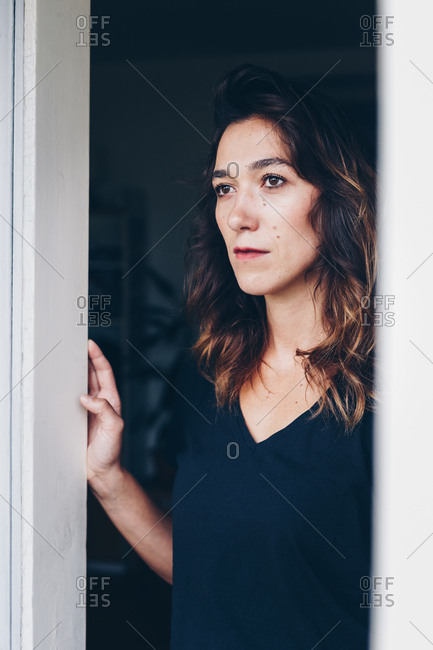 Portrait of a natural and beautiful woman in her apartment