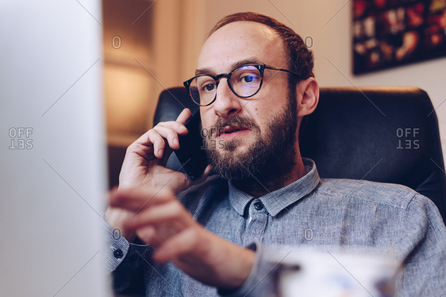 Freelancer man talking to colleague over video call on laptop, solving a problem